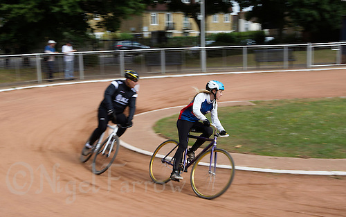 21 JUN 2015 - LONDON, GBR - Chloe Pearce (right) of Ipswich Eagles leads Kevin Smith (left) of East London during the final heat of their South East League Two cycle speedway fixture at Canning Town Recreation Ground in London, Great Britain (PHOTO COPYRIGHT © 2015 NIGEL FARROW, ALL RIGHTS RESERVED)