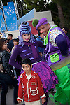 A boy posing with some Whos in Whoville at Grinchmas at Universal Studios Hollywood in Los Angeles, CA