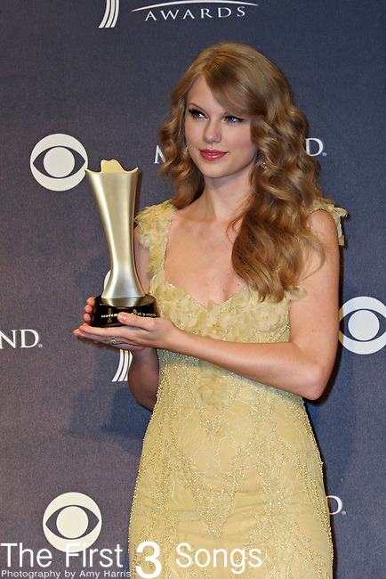 Taylor Swift with the award for Entertainer of the Year in the press room at the 46th Annual Academy of Country Music Awards in Las Vegas, Nevada on April 3, 2011.