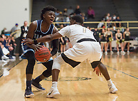 NWA Democrat-Gazette/CHARLIE KAIJO Springdale Har-Ber High School Tyler Garrett (2) looks for an opening past Bentonville High School guard Cadarius Baggett (1) during a basketball game on Friday, January 12, 2018 at Bentonville High School in Bentonville.