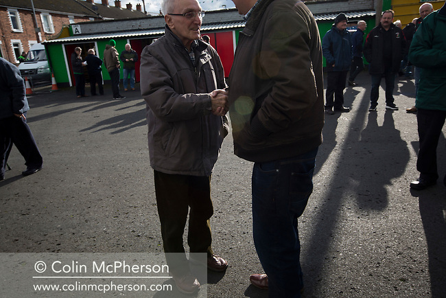 Home supporters gathering inside The Oval, Belfast before Glentoran hosted city-rivals Cliftonville in an NIFL Premiership match. Glentoran, formed in 1892, have been based at The Oval since their formation and are historically one of Northern Ireland's 'big two' football clubs. They had an unprecendentally bad start to the 2016-17 league campaign, but came from behind to win this fixture 2-1, watched by a crowd of 1872.