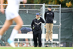 28 October 2012: UNC head coach Anson Dorrance (left), with assistant coach Cindy Parlow Cone, takes a phone call during the second half. The University of North Carolina Tar Heels played the University of Virginia Cavaliers at Fetzer Field in Chapel Hill, North Carolina in a 2012 NCAA Division I Women's Soccer game. Virginia defeated UNC 1-0 in their Atlantic Coast Conference quarterfinal match.