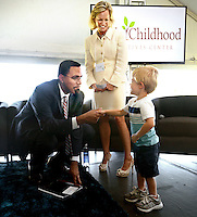 NWA Democrat-Gazette/BEN GOFF @NWABENGOFF<br /> Whitten Smith, 2, a student at the Helen R. Walton Children's Enrichment Center, greets John King, Jr., Deputy U.S. Secretary of Education, and Sara Lilygren, executive vice president for corporate affairs with Tyson Foods, Inc., on Thursday Sept. 17, 2015 during a panel discussion on early childhood development at the future site of a new Helen R. Walton Children's Enrichment Center and Early Childhood Initiatives Center on N.E. J St. in Bentonville.