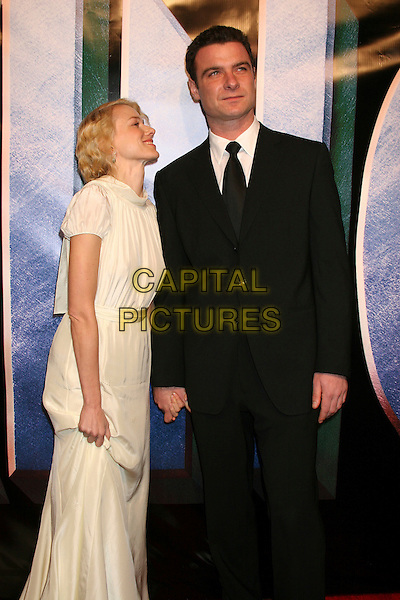 "NAOMI WATTS & LIEV SCHREIBER.Universal Pictures' ""King Kong"" New York City Premiere - Arrivals at Loews E-Walk & AMC Empire Cinemas, New York City..December 5th, 2005 .Ref: IW.half length white dress black suit profile looking up holding hands.www.capitalpictures.com.sales@capitalpictures.com.©Capital Pictures"