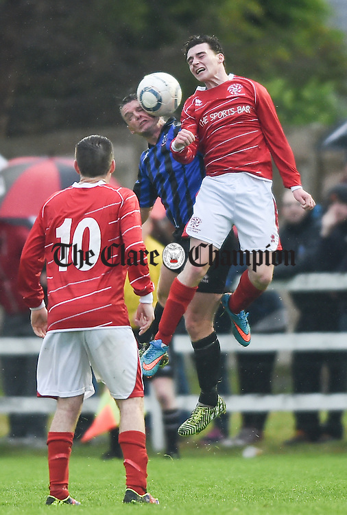 Anton Mannering of Bridge United in action against Ian Collins of Newmarket Celtic during their Cup final at Doora. Photograph by John Kelly.