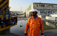 QATAR, Doha, industrial complex outside the city, migrant worker  / KATAR, Doha, Industriekomplex ausserhalb der Stadt, Gastarbeiter vor Sammelunterkunft