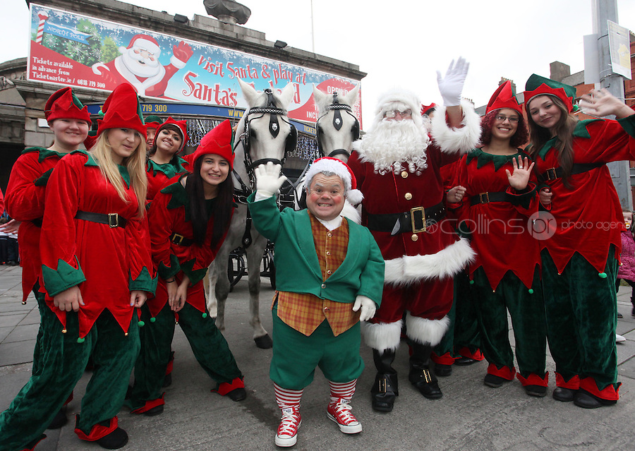 ****NO FEE PIC ******.19/11/2011.Santa Claus, Santas Helpers & Bubbles the Elf after a Christmas Parade.at the opening of Santa's Playland in The Ambassador Theatre,Dublin.One of this Christmas' biggest events is coming!  Santa's Playland takes up residence at The Ambassador Theatre in preparation for this year's festive season.  The spectacular event opens on Saturday 19 November and runs until Friday 23 December. Santa's Playland will see children transported to a magical Christmas paradise.On entering Santa's Playland children will be treated to a special Christmas play time.  The Play Area is full of Christmas treats with bouncy castles, slides and Christmas displays..Photo: Gareth Chaney Collins
