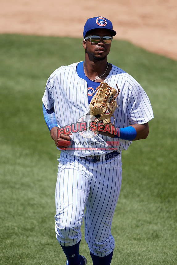South Bend Cubs left fielder Eloy Jimenez (27) jogs to the dugout during the first game of a doubleheader against the Peoria Chiefs on July 25, 2016 at Four Winds Field in South Bend, Indiana.  South Bend defeated Peoria 9-8.  (Mike Janes/Four Seam Images)