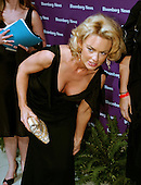 "Kelly Carlson star of the TV show ""Nip Tuck"" adjusts her dress as she arrives at the Embassy of the Republic of Macedonia in Washington, D.C. for the Bloomberg News party following the annual White House Correspondents Association (WHCA) dinner on April 29, 2006..Credit: Ron Sachs / CNP"