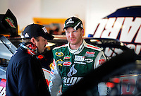 Feb 07, 2009; Daytona Beach, FL, USA; NASCAR Sprint Cup Series driver Dale Earnhardt Jr (right) talks with crew chief Tony Eury Jr during practice for the Daytona 500 at Daytona International Speedway. Mandatory Credit: Mark J. Rebilas-