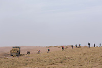 Chinese afforestation workers poke straw partway into the sand, forming a pattern of small squares in the desert areas of Minqin county in Gansu province, October 2016. The grid like network of straw fences break the force of the wind at ground level, stopping dune movement by confining the sand within the squares of the grid. Minqin county is located in between the Tengger Desert and the Badain Jaran Desert.