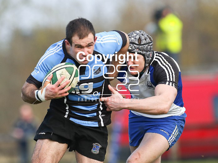 02.03.13 Shannon V Cork Constitution, Ulster Bank All Ireland League, Coonagh, Limerick. Shannon's Eric Maloney shakes off a tackle from Con's Niall O'Driscoll on his way to scoring a try. Pic. Alan Place / Press 22