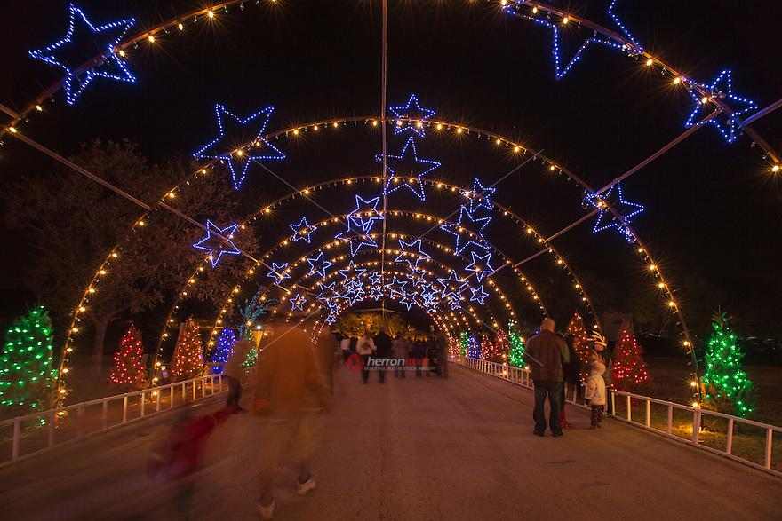 Zilker Park Trail of Lights Starry Night Tunnel | HerronStock.com
