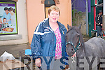 Anne O'Sullivan from Clonkeen Killarney admiring the horses at the traditional fair day in Kenmare.