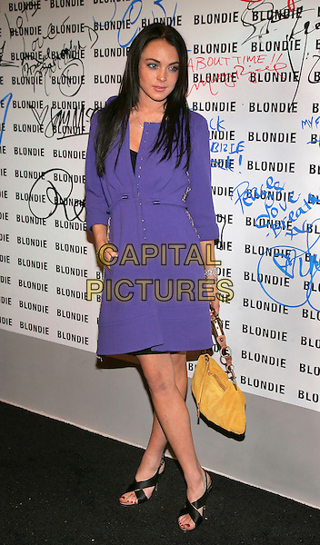LINDSAY LOHAN.At celebration of Blondie's rock and roll hall of fame induction honoring Debbie Harry at Stephen Weiss Studio, New York, NY, USA.  .March 9th, 2006.Photo: Jackson Lee/Admedia/Capital Pictures.Ref: JL/ADM.full length purple dress yellow bag purse.www.capitalpictures.com.sales@capitalpictures.com.© Capital Pictures.