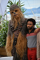 Donald Glover &amp; Chewbacca at the photocall for &quot;Solo: A Star Wars Story&quot; at the 71st Festival de Cannes, Cannes, France 15 May 2018<br /> Picture: Paul Smith/Featureflash/SilverHub 0208 004 5359 sales@silverhubmedia.com
