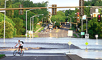 "Bill Gaul, Iowa State University graduate student from Des Moines, turns back from flood water covering the intersection of Lincoln Way and University Blvd. Werdnesday morning in Ames.  ""I guess I won't be going to campus today,"" he said.   Flooding in Ames, Iowa Wednesday, August 11, 2010 from the flooded South Skunk River and Squaw Creek."