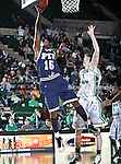 Florida International University Panthers forward Eric Fredrick (15) goes up for a lay up past North Texas Mean Green center Ben Knox (15) in the NCAA  basketball game between the Florida International University Panthers and the University of North Texas Mean Green at the North Texas Coliseum,the Super Pit, in Denton, Texas. UNT defeated FIU 87 to 77