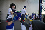 Bolton Wanderers 3 Liverpool 1, 21/01/2012. Reebok Stadium, Premier League. Two club mascots on stilts handing out sweets to supporters outside the home supporters end at the Reebok Stadium, before Bolton Wanderers take on Liverpool in a Barclays Premier League game. The match was won by Bolton by 3 goals to 1, watched by a near-capacity crowd of 26,854. The win lifted Bolton out of the relegation places in England's top division, while Liverpool remained seventh. Photo by Colin McPherson.