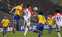 Costa Rica's Josue Martinez (17) headers the ball past Brazil's Dalton (3) and Rafael Toloi (4) during the FIFA Under 20 World Cup Semi-final match at the Cairo International Stadium in Cairo, Egypt, on October 13, 2009. Brazil won the match  1-0.