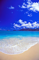 Blue water and gentle waves wash up on the sandy shores of Waimanalo's pristine Beach.