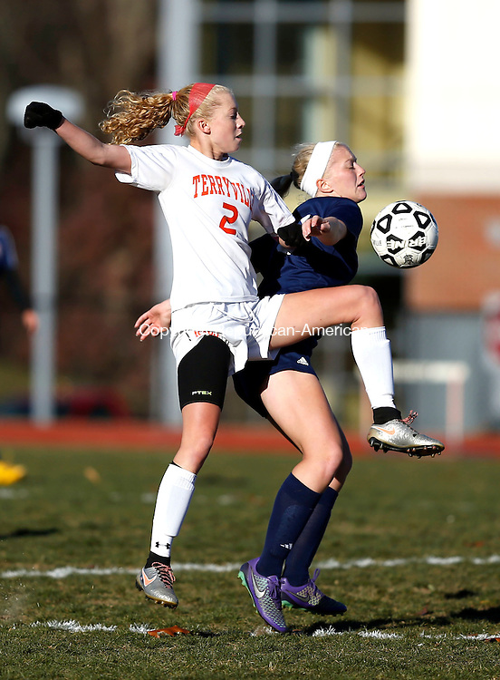 Terryville, CT- 11 November 2016-111116CM11- Terryville's Jenna Covello left, goes up for the ball against Bolton's Rachel Zimmerman during their state tournament matchup on Friday.     Christopher Massa Republican-American