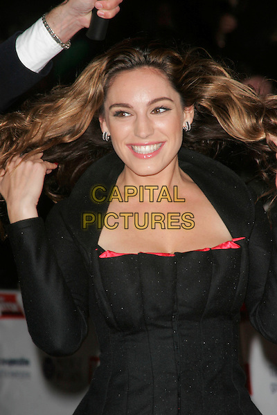 KELLY BROOK.The Pride of Britain Awards, London Television Centre, South Bank, London, England, UK, .September 30th, 2008 .half length black top jacket long sleeves red cleavage curl wavy hair jacket hands hair .CAP/AH.©Adam Houghton/Capital Pictures.