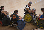 Danny White, center, and other athletes participate in the 8th Annual FourPlay! Quad Rugby Tournament in the Ping Recreation Center on Oct. 4, 2014. Photo by Lauren Pond