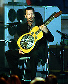 "Eric Clapton performs during the ""Concert of the Century for VH1 Save the Music"" at the White House in Washington, D.C. on October 23, 1999..Credit: Ron Sachs - Pool / CNP"