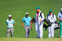Kevin Kisner (USA) Tiger Woods (USA) Justin Thomas (USA) on the 2nd fairway during Wednesdays preview at the The Masters , Augusta National, Augusta, Georgia, USA. 10/04/2019.<br /> Picture Fran Caffrey / Golffile.ie<br /> <br /> All photo usage must carry mandatory copyright credit (&copy; Golffile | Fran Caffrey)