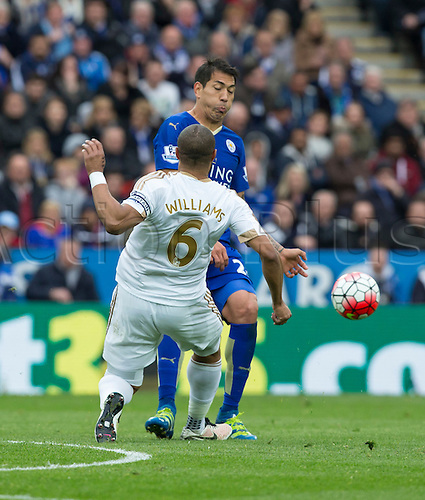 24.04.2016. King Power Stadium, Leicester, England. Barclays Premier League. Leicester versus Swansea. Leicester City striker Leonardo Ulloa and Swansea City defender Ashley Williams (C) come together as they both try to take possession of the ball.