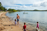 Family walking along Bach Beach.  Thursday Island, Torres Strait Islands, Queensland, Australia