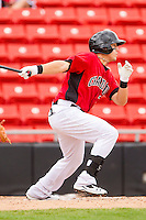 Jacob Skole #7 of the Hickory Crawdads laces an RBI single to left field against the Greensboro Grasshoppers at L.P. Frans Stadium on May 18, 2011 in Hickory, North Carolina.   Photo by Brian Westerholt / Four Seam Images