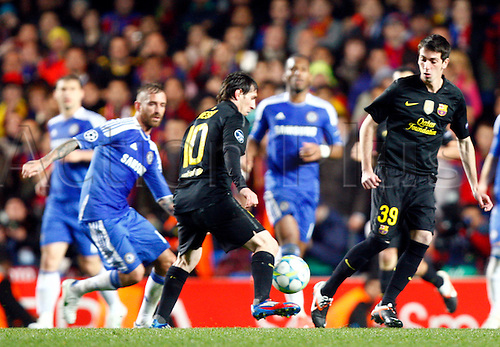 18.04.2012. Stamford Bridge, Chelsea, London. .Lionel Messi of  FC Barcelona and Issac Cuenca of  FC Barcelona .during the Champions League Semi Final 1st  leg match between Chelsea and Barcelona  at Stamford Bridge, Stadium on April 18, 2012 in London, England.............