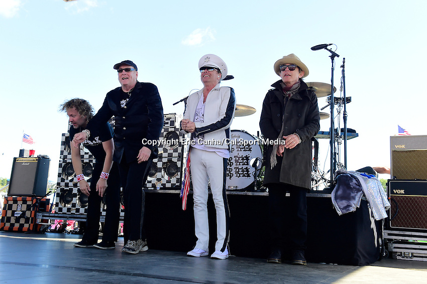 Sunday, September 25, 2016: Cheap Trick performs for spectators before the NASCAR Sprint Cup Series Bad Boy Off Road 300 race held at the New Hampshire Motor Speedway in Loudon, New Hampshire. Sprint Cup Series driver Kevin Harvick (4) won the race. Eric Canha/CSM