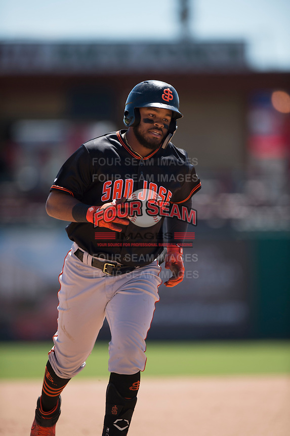 San Jose Giants center fielder Heliot Ramos (13) rounds the bases after hitting a home run during a California League game against the Stockton Ports on April 9, 2019 in Stockton, California. San Jose defeated Stockton 4-3. (Zachary Lucy/Four Seam Images)