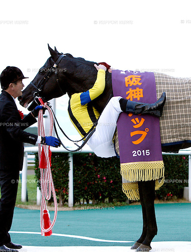 Rosa Gigantea ( Mirco Demuro),<br /> DECEMBER 26, 2015 - Horse Racing :<br /> Jockey Mirco Demuro celebrates with Rosa Gigantea after winning the Hanshin Cup at Hanshin Racecourse in Hyogo, Japan. (Photo by Eiichi Yamane/AFLO)