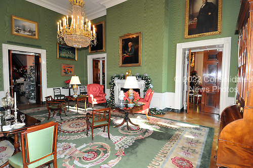 """Washington, DC - December 3, 2008 -- Wide view of the Green Room showing the mantel draped in green garland laden with silver eagles and stars during a media preview of the 2008 holiday decorations and tasting event on the State Floor of the White House in Washington, D.C. on Wednesday, December 3, 2008.  The theme of this years decorations is """"a Red, White, and Blue Christmas""""..Credit: Ron Sachs / CNP"""