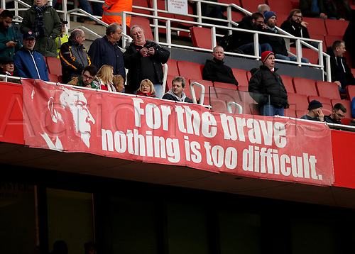 "11th March 2018, Emirates Stadium, London, England; EPL Premier League Football, Arsenal versus Watford; Giant banner with Arsenal manager Arsene Wenger face on it saying ""For the brave nothing is too difficult"" inside Emirates Stadium"