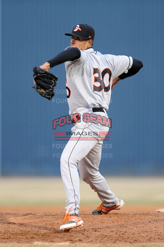 Delmarva Shorebirds pitcher Dennis Torres #30 delivers a pitch during a game against the  Asheville Tourists at McCormick Field on April 5, 2014 in Asheville, North Carolina. The Tourists defeated the Shorebirds 5-3. (Tony Farlow/Four Seam Images)