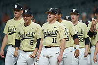Vanderbilt Commodores teammates stand at home plate waiting for a runner to score against the Houston Cougars during game nine of the 2018 Shriners Hospitals for Children College Classic at Minute Maid Park on March 3, 2018 in Houston, Texas. The Commodores defeated the Cougars 9-4. (Brian Westerholt/Four Seam Images)