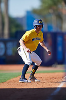 Michigan Wolverines left fielder Miles Lewis (3) leads off third base during a game against Army West Point on February 17, 2018 at Tradition Field in St. Lucie, Florida.  Army defeated Michigan 4-3.  (Mike Janes/Four Seam Images)