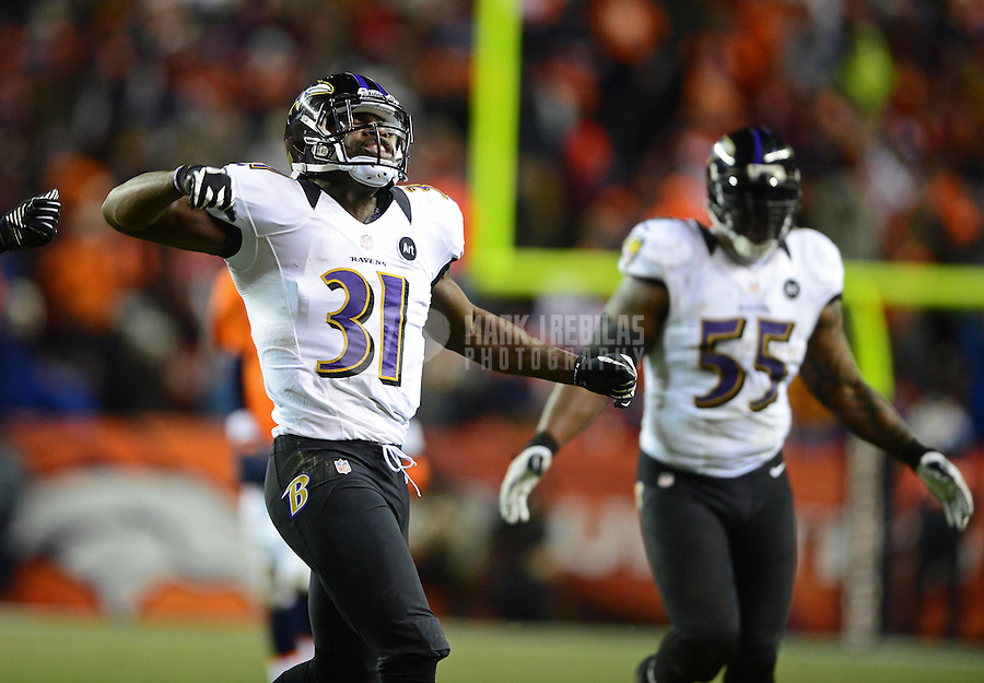 Jan 12, 2013; Denver, CO, USA; Baltimore Ravens safety Bernard Pollard (31) celebrates a play against the Denver Broncos during the AFC divisional round playoff game at Sports Authority Field.  Mandatory Credit: Mark J. Rebilas-