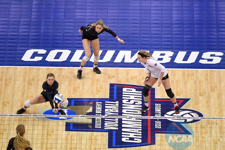COLUMBUS, OH - DECEMBER 17:  Halland McKenna (17) of Stanford University returns a serve against the University of Texas during the Division I Women's Volleyball Championship held at Nationwide Arena on December 17, 2016 in Columbus, Ohio.  Stanford defeated Texas 3-1 to win the national title. (Photo by Jamie Schwaberow/NCAA Photos via Getty Images)
