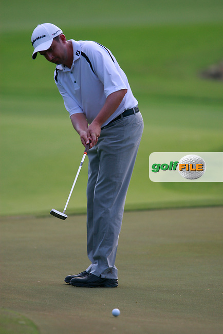 Peter Lawrie (IRL) takes his putt on the 4th green during Friday's resumed Round 2 of the 2011 Barclays Singapore Open, Singapore, 11th November 2011 (Photo Eoin Clarke/www.golffile.ie)