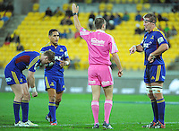 Highlanders captain Brad Thorn chats with referee Mike Fraser during the Super Rugby match between the Hurricanes and Highlanders at Westpac Stadium, Wellington, New Zealand on Saturday, 6 July 2013. Photo: Dave Lintott / lintottphoto.co.nz