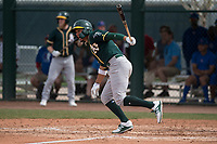 Oakland Athletics third baseman Edwin Diaz (16) follows through on his swing during a Minor League Spring Training game against the Chicago Cubs at Sloan Park on March 13, 2018 in Mesa, Arizona. (Zachary Lucy/Four Seam Images)
