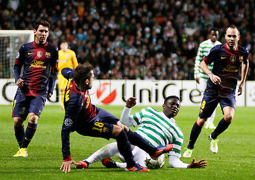 07.11.2012 Glasgow, Scotland. Victor Wanyama, Lionel Messi, Jordi Alba and Andres Iniesta  in action during the Champions League game between Celtic and Barcelona from Celtic Park.