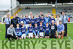 The St Olivers NS team with their heroes Aidan O'Mahony and Paul Murphy and Tom Spillane at the Killarney Garda National School football blitz in Fitzgerald Stadium on Thursday