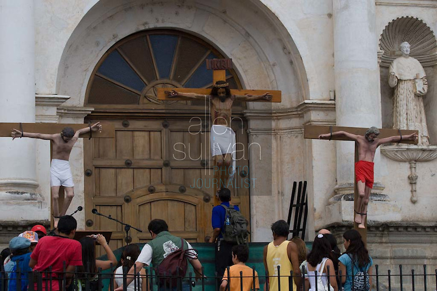 People visit an image of Jesus during the Penance of Jesus procession.